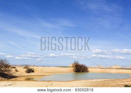 small pond in desertic landscape