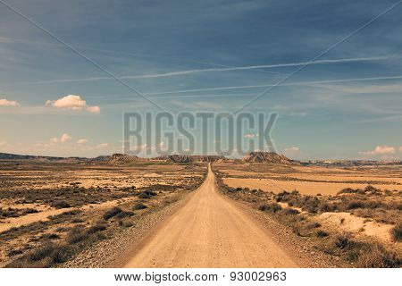 dirt track trough desert
