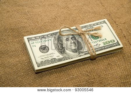 One Pack Of Dollars On An Old Cloth