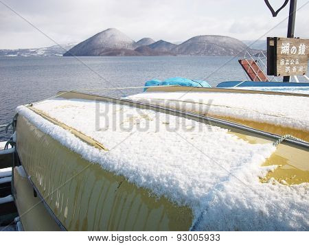 snow on yellow fishery boat