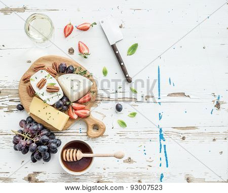 Cheese appetizer selection or wine snack set. Variety of cheese, grapes, pecan nuts, strawberry and