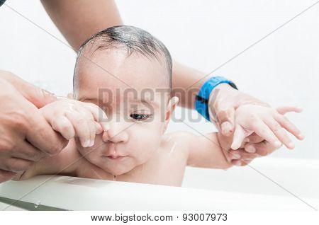 Cute baby boy in the bathtub