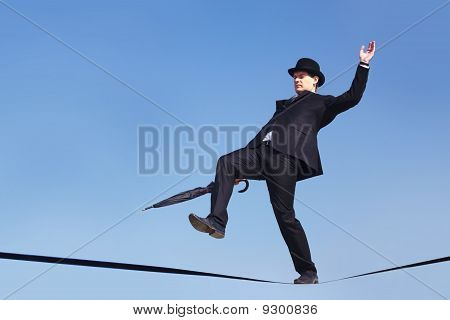 Businessman Balancing on tightrope
