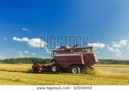 Farm Combine Harvester With Elevator To Upload Cereal Into Trailer