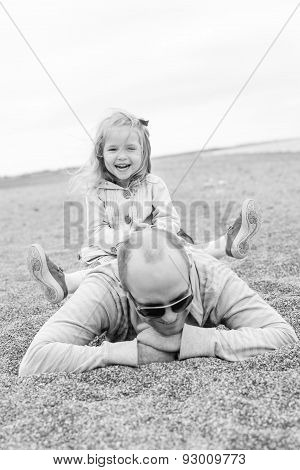 Happy Girl Playing With Her Father