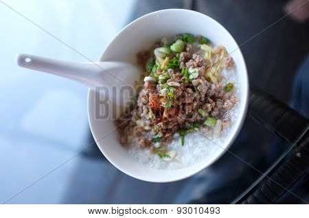 Soft boiled rice with mince pork, Congee