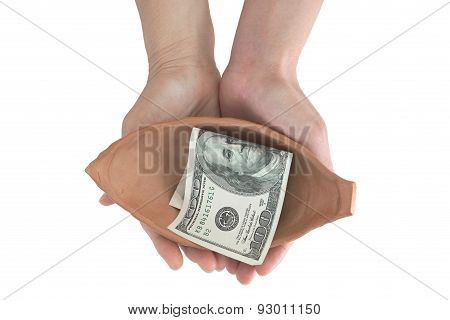 Woman hand holding pottery with single dollar note