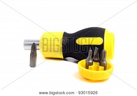 Phillips Screwdriver And A Screwdriver With Different With Nozzles On A White Background