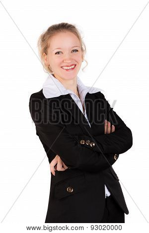 Laughing woman in black suit standing  with crosswised arms