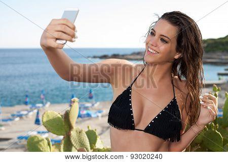 Woman Take A Selfie On A Beach