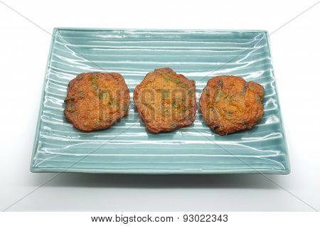 Fried fish patty, spicy fish ball on ceramic dish, thai food
