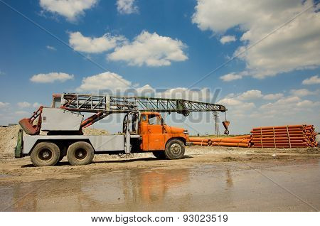 Truck With Crane Working At Construction Site