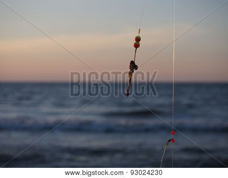 fishing-rod with bait on a sea background