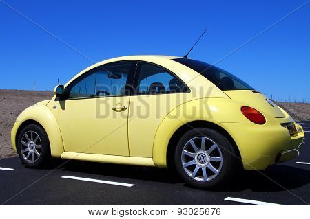 Yellow Volkswagen Beetle - back view