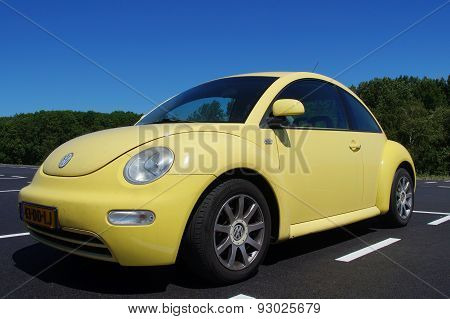 Yellow Volkswagen Beetle - front view