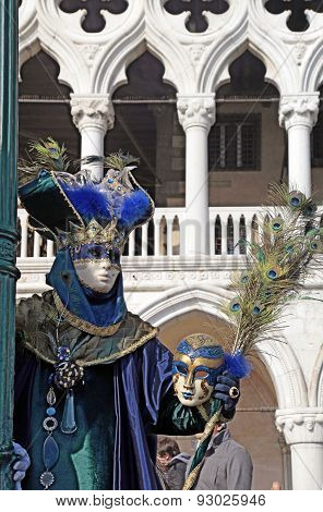 Costumed People In Venetian Mask During Venice Carnival