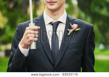 Boutonniere On His Jacket