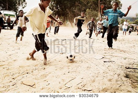 Children playing soccer in township, South Africa.