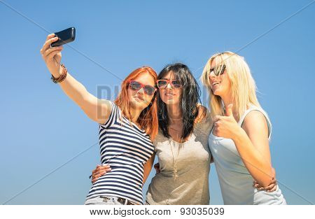 Happy Girlfriends Taking Selfie Against Blue Sky - Friendship Summer Concept With New Trends