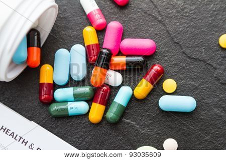 Many Pills And Tablets On Black Background.