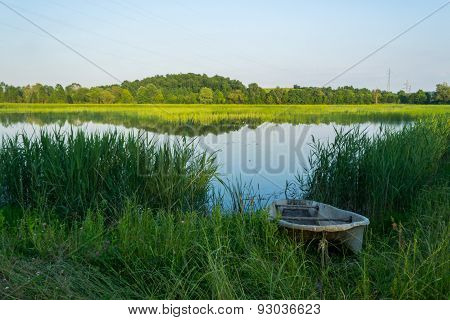 Fishing Boat on a Pond