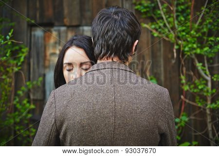 Peaceful woman with closed eyes standing close to her sweetheart