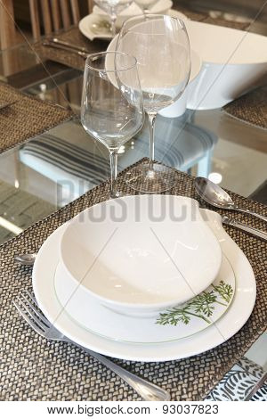 Crockery Set Over A Table Ready To Be Served