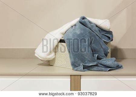 Dirty Towels In A Basket Ready To Be Washed