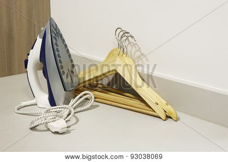 Flat Iron And Cloth Hooks In A Modern Kitchen