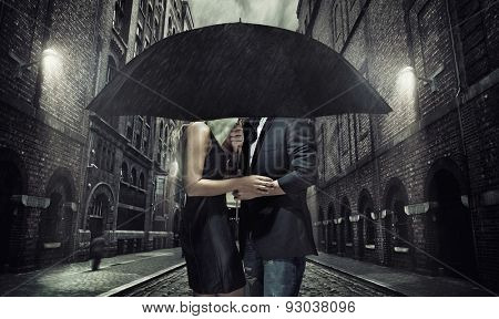 Elegant couple on rainy evening
