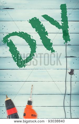 The word diy against tools on wooden background