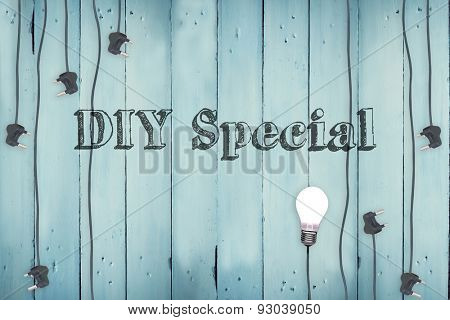 The word diy special against plugs on wooden background