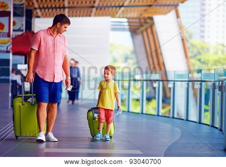 Happy Father And Son Are Ready For Boarding In International Airport