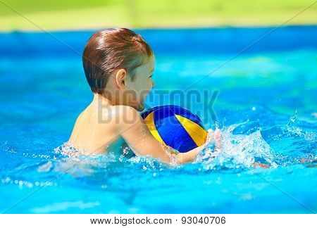 Happy Kid Playing Water Sport Games In Pool