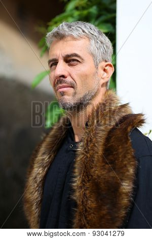 Portrait Of A Sexy Man In Wolf  Fur, Looking Out Into The Distance.