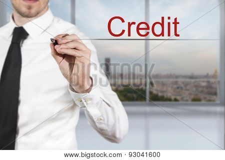 Businessman Writing Credit In The Air
