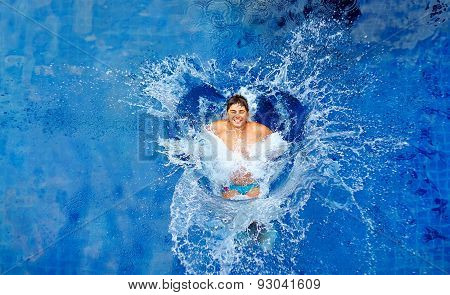 Man Jumping In Pool, Huge Splash, Top View