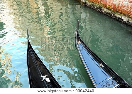 Two Romantic Gondolas On A Venetian Canal