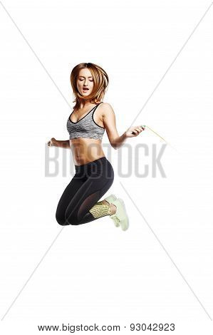 Hot Fitness Girl Doing Exercise In Studio With Jumping Rope