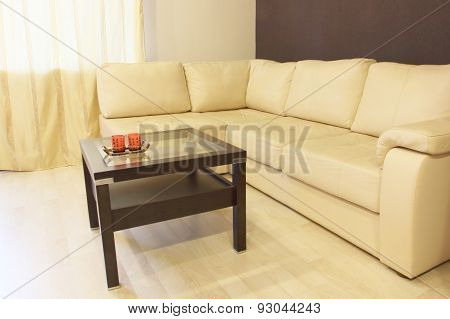 Modern White Corner Leather Sofa And Coffee Table.