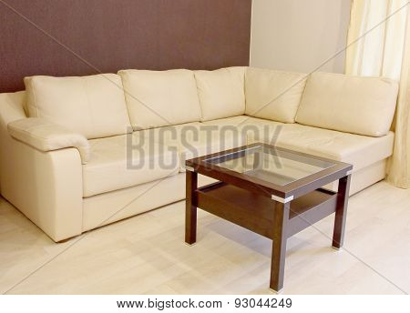 White Corner Leather Sofa And Coffee Table.