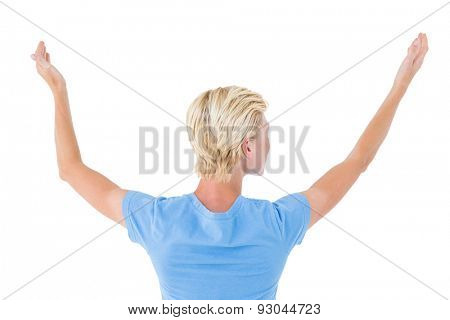 Blonde woman gesturing back to camera on white background