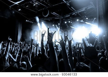 Cheering Crowd Throwing Horns at a Concert