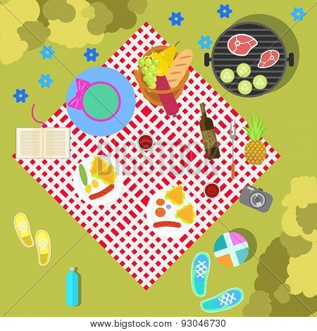 Summer picnic on nature landscape with blanket and basket of food, top view