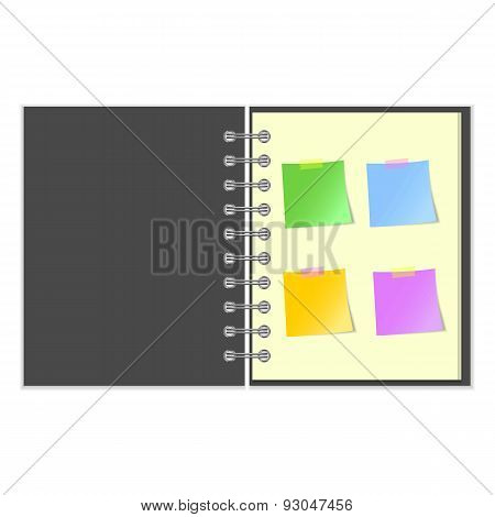 Open grey cover notebook with stickers