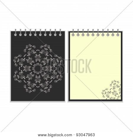 Black cover notebook with round ornate star pattern