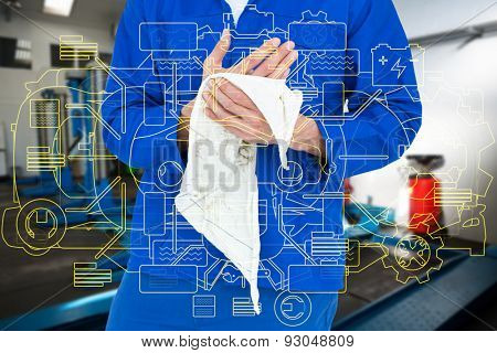 Cropped image of mechanic wiping hand with napkin against empty work stations