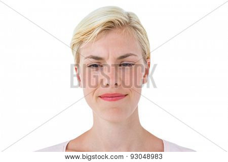 Serious woman frowning on white background