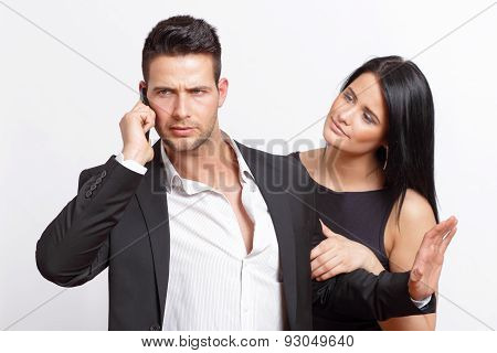 Businessman bothered by his girlfriend