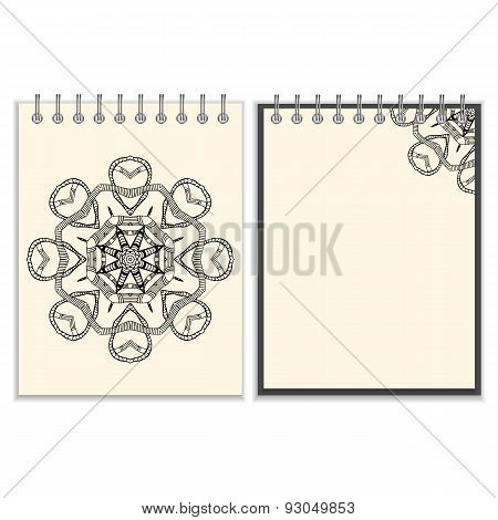 White cover notebook with handmade black pattern